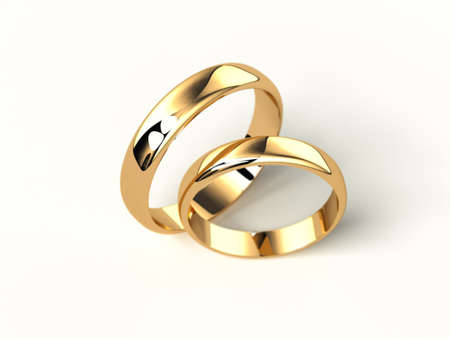 circulo de personas: two gold wedding rings isolated on white background