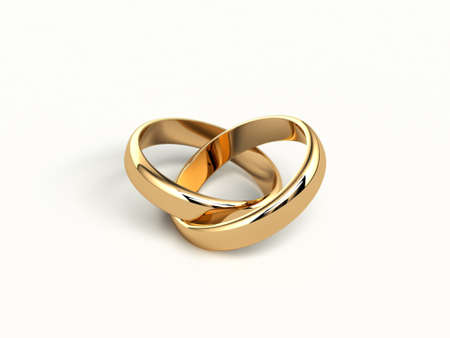 wedding rings: two gold wedding rings isolated on white background
