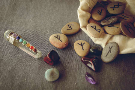 divination: divination and prediction on runes and Tarot, mysticism or esoteric isolated on grey background