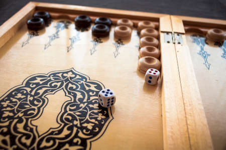 vintage wooden backgammon pattern and the dice Stock Photo