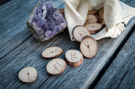 runes: wood runes handmade on an old wooden table. Esoteric subjects
