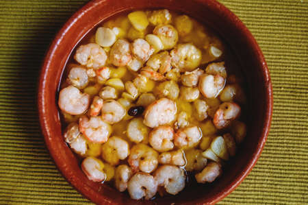 ajillo: on the table in a clay pot ready Gambas sauce