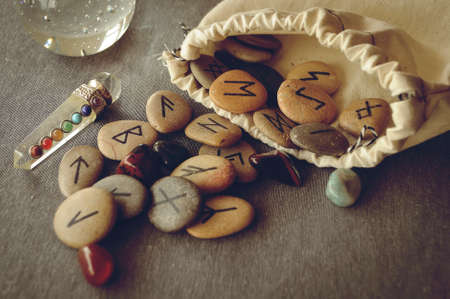 mysticism: divination and prediction on runes and Tarot, mysticism or esoteric isolated on grey background