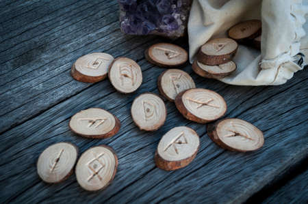 psychic: wood runes handmade on an old wooden table. Esoteric subjects