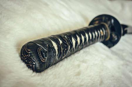 katana sword: closeup details katana sword on white fur Stock Photo
