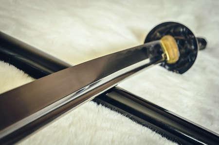 bushido: closeup details katana sword on white fur Stock Photo