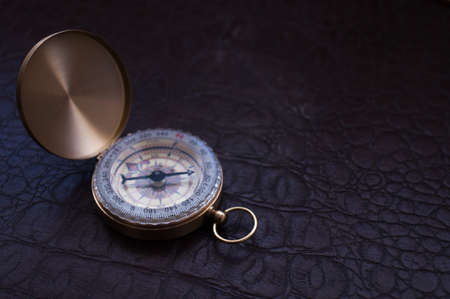azimuth: on the surface of the leather lies open the Golden compass