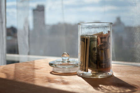 holiday budget: money in the jars on the table, savings for vacation Stock Photo