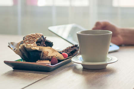 Delicious chocolate muffin with chocolate chips and fresh coffee for Breakfast best way to start the morning. Stock Photo