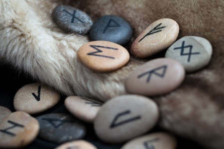 futark stone runes handmade on the fur Stock Photo