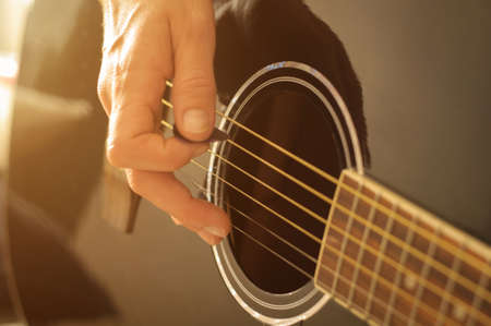 playing acoustic guitar