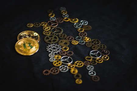 clockwork and bitcoin coin Stock Photo