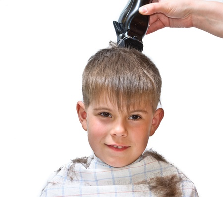 Boy mows clipper. Isolated on white background photo.