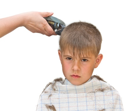 mows: Boy mows clipper. Isolated on white background photo.