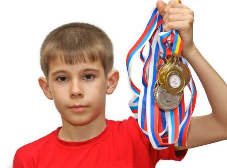 Boy-athlete with medals. Isolated on white background.