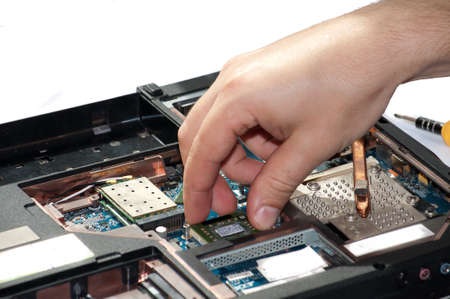 conducts: Laptop repair. The specialist conducts repairs laptop motherboard plans Stock Photo