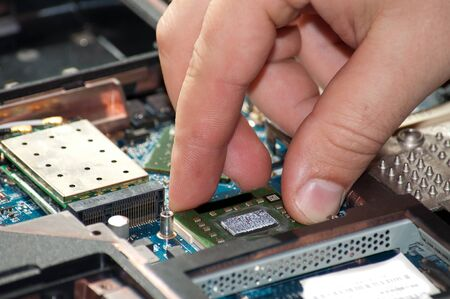 Laptop repair. The specialist conducts repairs laptop motherboard plans photo