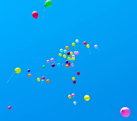 Many balloons fly into the blue sky Stock Photo - 9615632