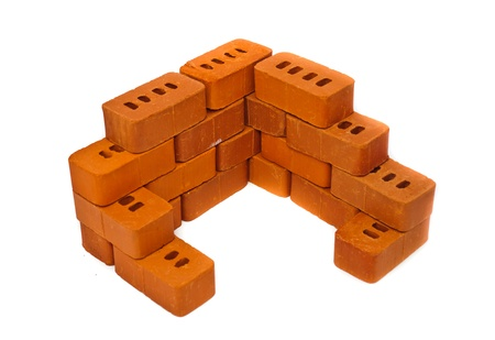 Small bricks for construction. Isolated on white background photo
