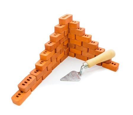 Small trowel and bricks for construction. Isolate on white background