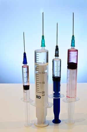 The composition of the needles. Syringes of various sizes Stock Photo - 9848362
