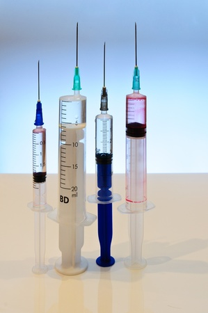 The composition of the needles. Syringes of various sizes photo