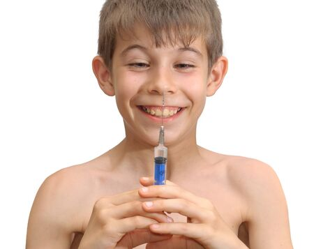 The boy and the syringe. Isolated on white background photo