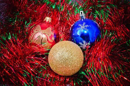 tinsel: Christmas decorations. Christmas decorations and tinsel in different colors.