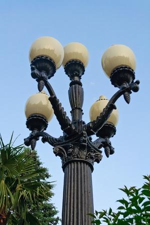 Street lamp on a pole against the blue sky photo