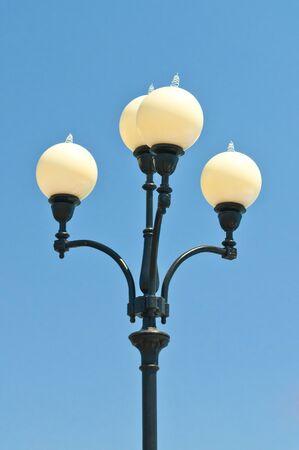 Street lamp on a pole against the blue sky Stock Photo - 10281634