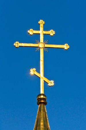 The church against the blue sky. Summer blue sky Orthodox Church photo