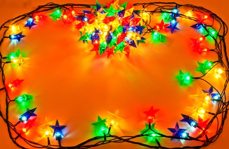 Garland of colored lights for Christmas trees. Spread out to a table Stock Photo