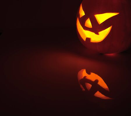 halloween ugly: Glowing pumpkin with a candle inside. Decorations for Halloween.