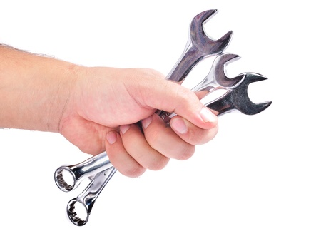 The hand with the wrench. Isolated on white background Standard-Bild