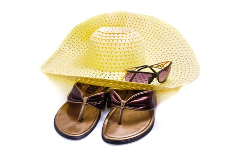 A straw hat and beach shoes. Isolated on white background photo