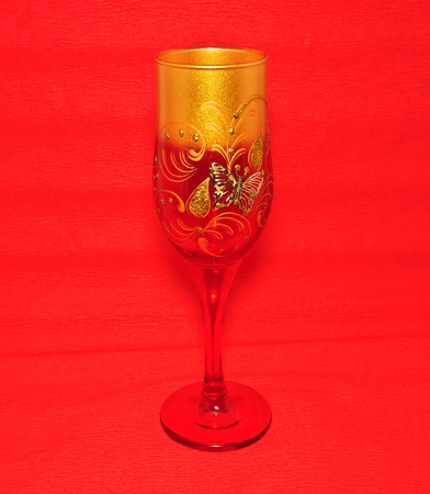 Red wine glass. Empty glass on red background photo