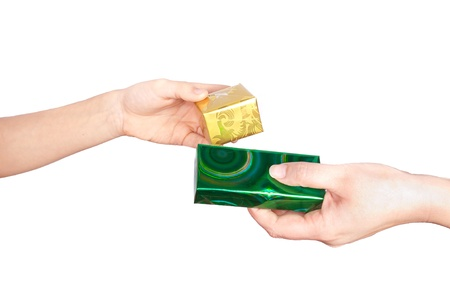 Hand with gift box. Isolated on white background Stock Photo - 11673301