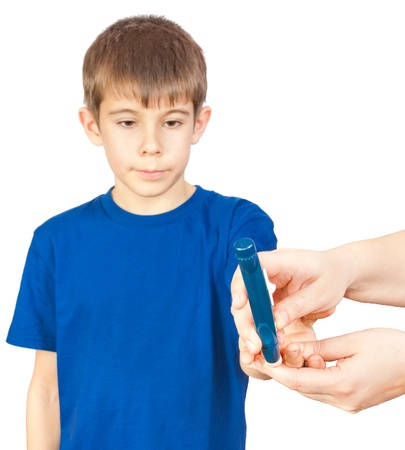 The boy is doing a test for diabetes. Photo isolated on white background
