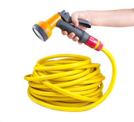 front or back yard: Equipment for watering garden. Hose and spray gun isolated on white background