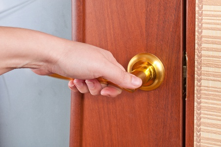 Hand and the door handle Archivio Fotografico