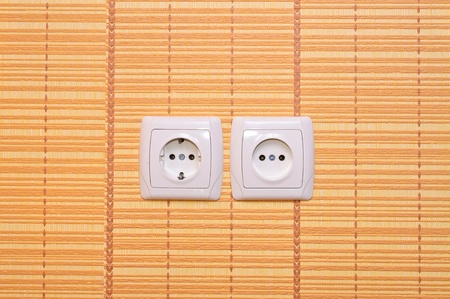 cut paper: Electrical outlet in the wall