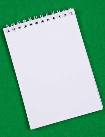 Pad of paper to take notes. Photo on a colored background photo