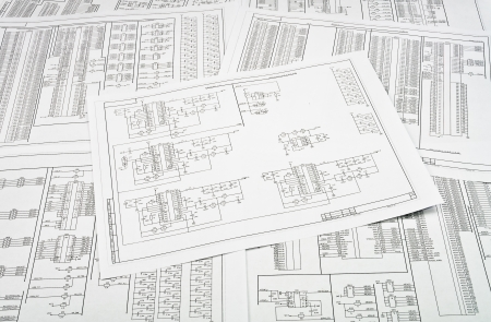 schematic: Background of several electrical circuits printed on paper