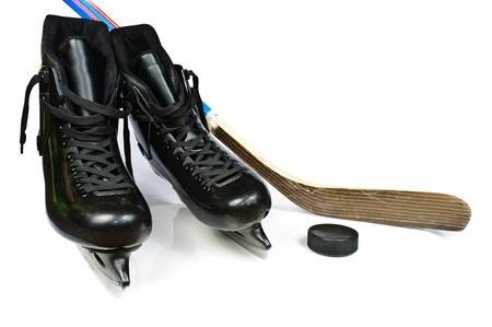 Hockey skates and stick. Isolated on white background
