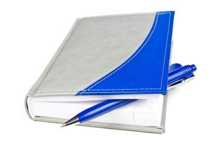 Organizer and ballpoint pen. Photos isolated on white background Stock Photo - 12225726