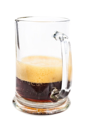 unstrained: Dark beer. Photo pour beer into a glass