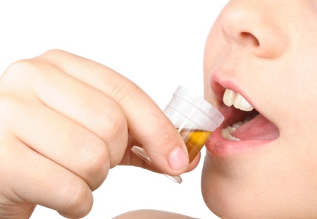 The child puts the pill into his mouth. Close-up Photos Stock Photo - 12682891