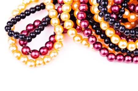Necklaces of colored balls. Close-up Photos photo