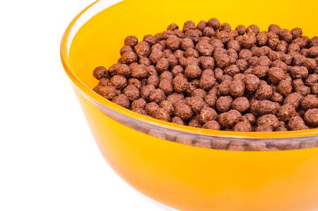 Breakfast cereals, chocolate balls. The photo on white background photo