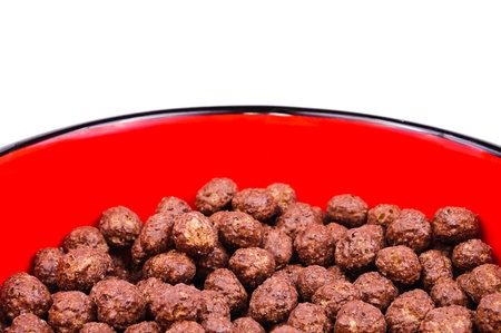 Breakfast cereals, chocolate balls  The photo on white background photo